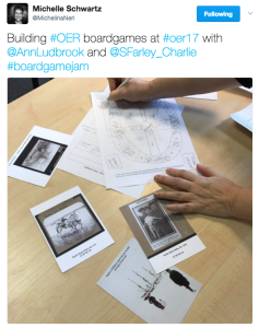 Picture of postcards with collections images, and a hand drawn board design for a game. Text reads: Building #OER boardgames at #oer17 with @AnnLudbrook and @Sfarley_Charlie #boardgamejam